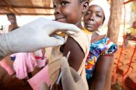 FILE PHOTO: A child is given a measles vaccination during an emergency campaign run by Doctors Without Borders in Likasa, Mongala province