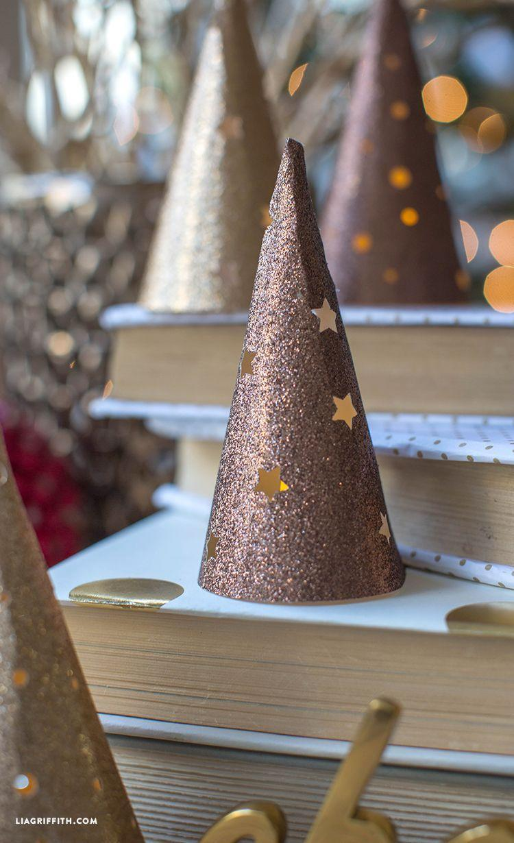 "<p>It's Christmas, so literally anything and everything can be Christmas tree shaped. Turn paper cones into glittered trees and cut stars into them. Place a tea light inside and it'll function like a lantern.</p><p>Get the tutorial at <a href=""https://liagriffith.com/paper-cone-lantern-christmas-tree/"" rel=""nofollow noopener"" target=""_blank"" data-ylk=""slk:Lia Griffith"" class=""link rapid-noclick-resp"">Lia Griffith</a>.</p>"