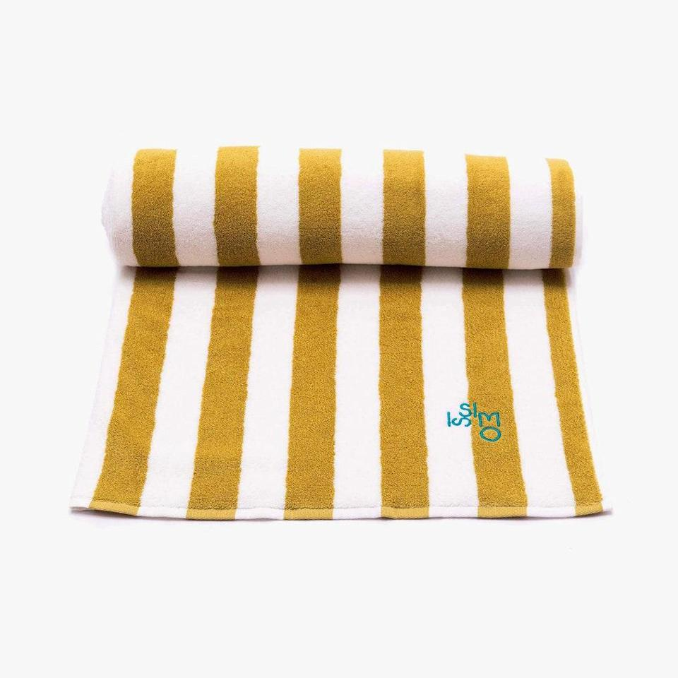 """Those Slim Aarons photos of sun-drenched bathers lying by a pool on a cliff that juts down to the sea? Those were taken at Il Pellicano. Their beach towels, with stripes of yellow and white, are just as chic. $155, ISSIMO. <a href=""""https://issimoissimo.com/prodotto/beach-towel/"""" rel=""""nofollow noopener"""" target=""""_blank"""" data-ylk=""""slk:Get it now!"""" class=""""link rapid-noclick-resp"""">Get it now!</a>"""