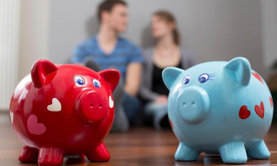 Young couple with piggy banks