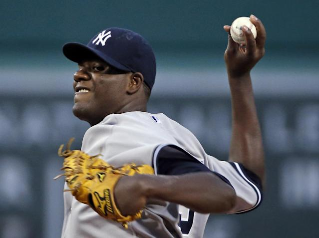 New York Yankees starting pitcher Michael Pineda delivers to the Boston Red Sox during the first inning of a baseball game at Fenway Park in Boston, Wednesday, April 23, 2014. (AP Photo/Elise Amendola)