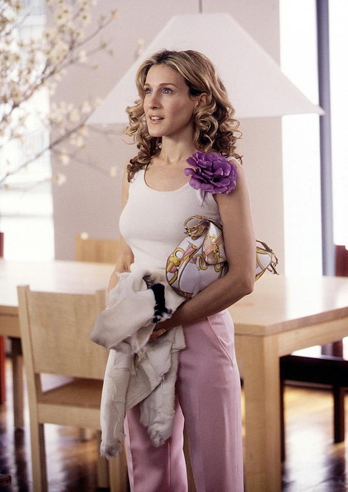 12. While flirting with Aidan at his furniture store at the start of Season 3, Carrie donned this adorable getup, which consisted of lavender Tuleh trousers, a purple pinned flower, and a delicious Dior saddle bag. Talk about a trendsetter!