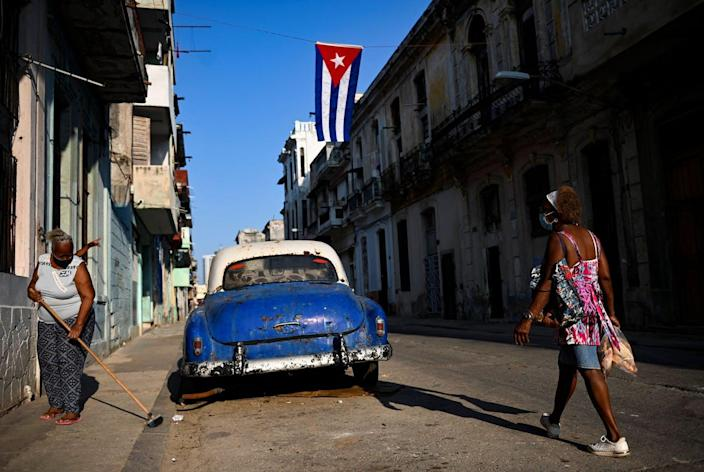 """<span class=""""caption"""">Street view of Havana, Cuba, July 26, 2021, several weeks after mass protests broke out.</span> <span class=""""attribution""""><a class=""""link rapid-noclick-resp"""" href=""""https://www.gettyimages.com/detail/news-photo/view-of-a-street-decorated-with-a-cuban-flag-in-tribute-to-news-photo/1234213570?adppopup=true"""" rel=""""nofollow noopener"""" target=""""_blank"""" data-ylk=""""slk:Yamil Lage/AFP via Getty Images"""">Yamil Lage/AFP via Getty Images</a></span>"""