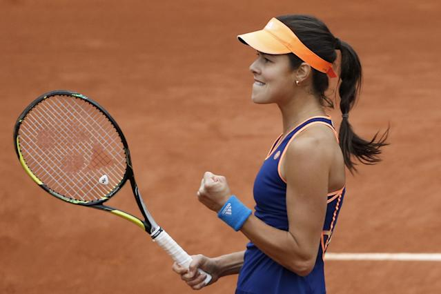 Serbia's Anna Ivanovic celebrates celebrates scoring a point in her second round match of the French Open tennis tournament against Ukraine's Elina Svitolina at the Roland Garros stadium, in Paris, France, Thursday, May 29, 2014. Ivanovic won in two sets 7-5, 6-2. (AP Photo/Darko Vojinovic)