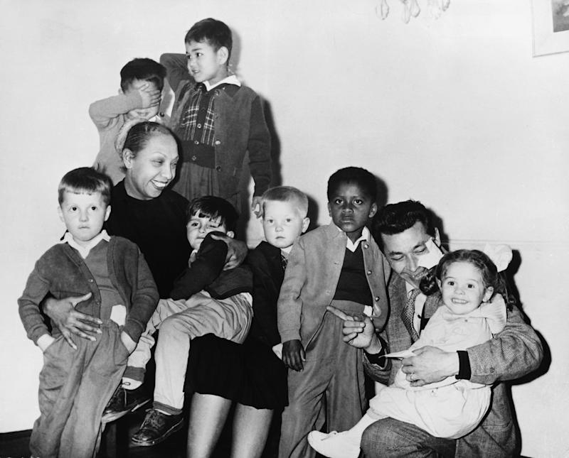 Singer Josephine Baker with her husband and adopted children, 1959. (Photo by © Hulton-Deutsch Collection/CORBIS/Corbis via Getty Images)