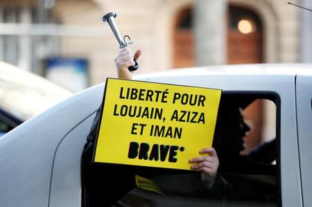 FILE PHOTO: Demonstrator from Amnesty International protests outside the Saudi Arabian Embassy on International Women's day in Paris