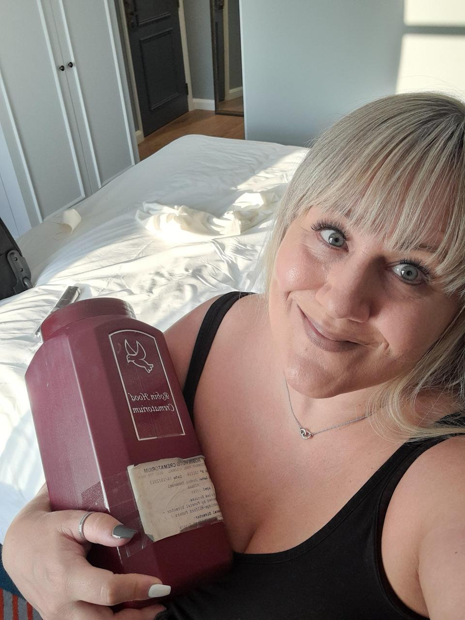 Pictured is Alison Cope in a selfie with her son's urn. Joshua Ribera was killed in a nightclub stabbing.