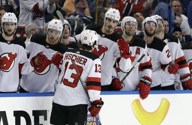 New Jersey Devils center Nico Hischier (13) celebrates with the bench after scoring against the Tampa Bay Lightning during the first period of Game 2 of an NHL first-round hockey playoff series Saturday, April 14, 2018, in Tampa, Fla. (AP Photo/Chris O'Meara)