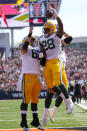 Green Bay Packers running back A.J. Dillon (28) celebrates a touchdown against the Cincinnati Bengals with guard Lucas Patrick (62) in the first half of an NFL football game in Cincinnati, Sunday, Oct. 10, 2021. (AP Photo/AJ Mast)