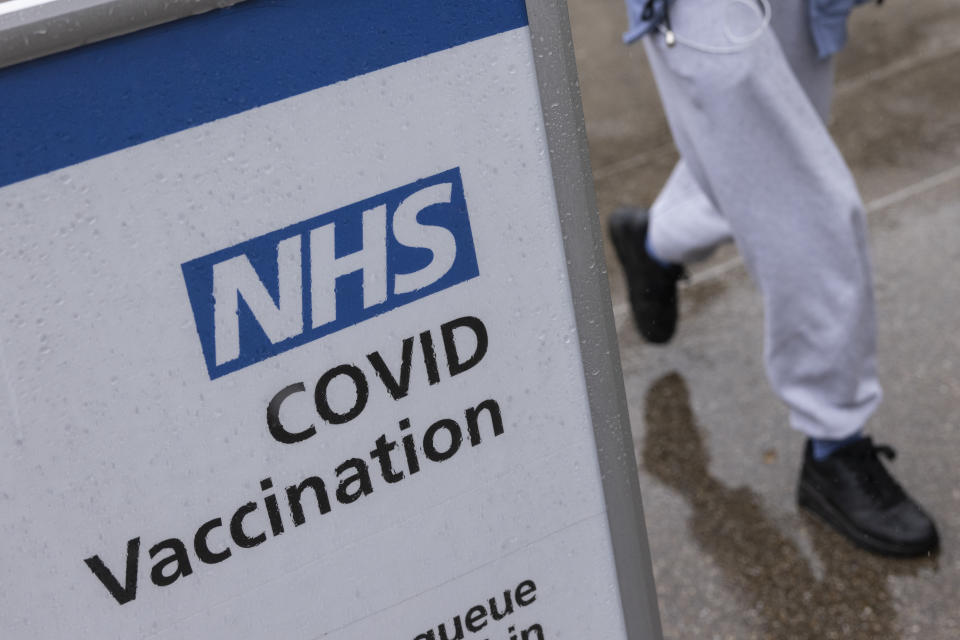 LONDON, UNITED KINGDOM - SEPTEMBER 13: A Covid-19 vaccination centre sign stands in the rain at St Thomas' hospital on September 13, 2021 in London, United Kingdom. Tomorrow, British Prime Minister Boris Johnson will set out his plan to manage Covid-19 through the winter, including what actions would need to be taken if the NHS hospital system were at risk of being overwhelmed. (Photo by Dan Kitwood/Getty Images)