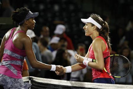 Mar 30, 2017; Miami, FL, USA; Johanna Konta of Great Britain shakes hands with Venus Williams of the United States (left) after their match in a women's singles semi-final during the 2017 Miami Open at Crandon Park Tennis Center. Konta won 6-4, 7-5. Mandatory Credit: Geoff Burke-USA TODAY Sports