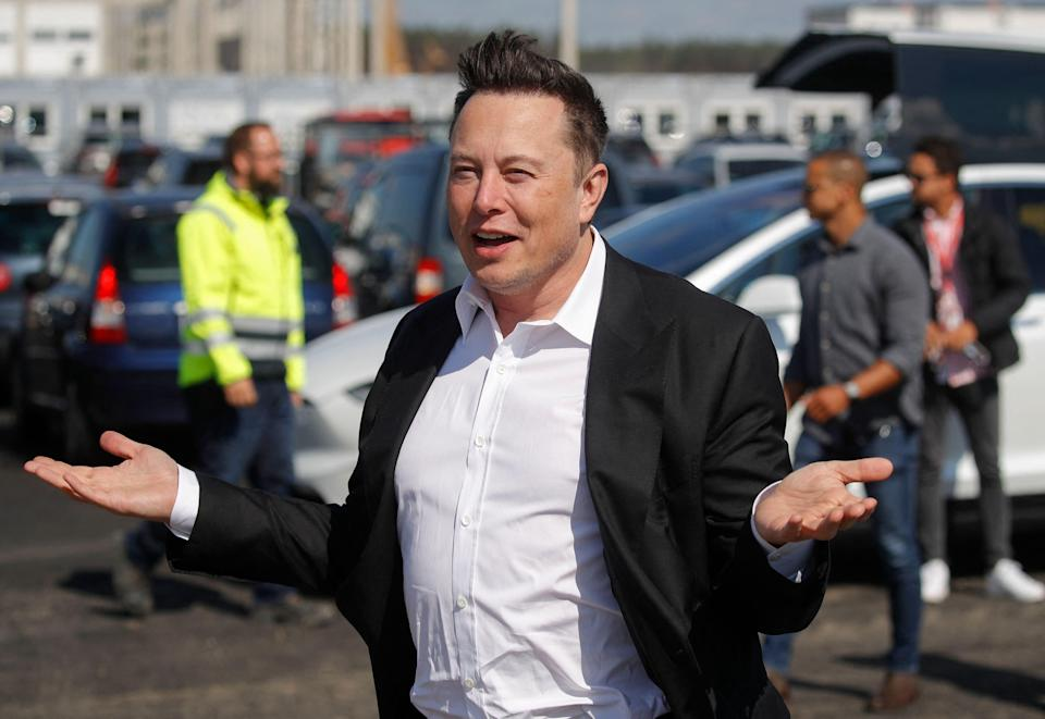 Tesla CEO Elon Musk gestures as he arrives to visit the construction site near Berlin.