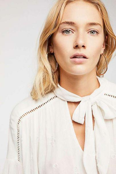 PHOTO: When you need a blouse that's sweet but not overly sentimental, look for one with subtle romantic touches rather than full-on ruffles. This one has it all: A touch of embroidery and bow that works tied or left undone. (Free People)