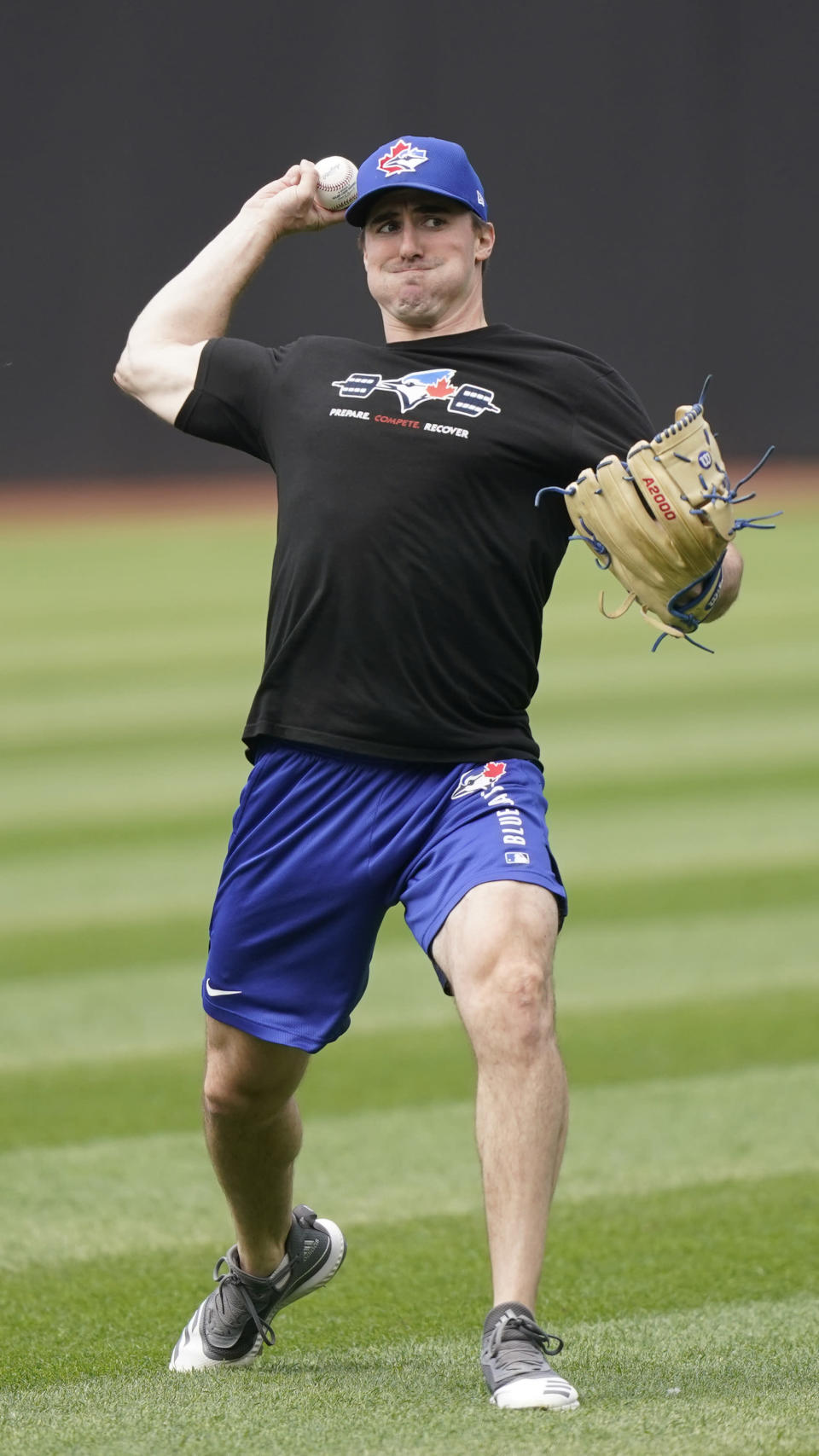 Toronto Blue Jays starting pitcher Ross Stripling warms up Saturday, May 29, 2021, in Cleveland. The baseball game between the Blue Jays and the Cleveland Indians was postponed due to inclement weather. The game will be rescheduled as a traditional doubleheader Sunday. (AP Photo/Tony Dejak)