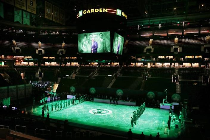 The Boston Celtics and the Brooklyn Nets observe a moment of silence for K.C. Jones before an NBA basketball game, Friday, Dec. 25, 2020, in Boston. (AP Photo/Michael Dwyer)