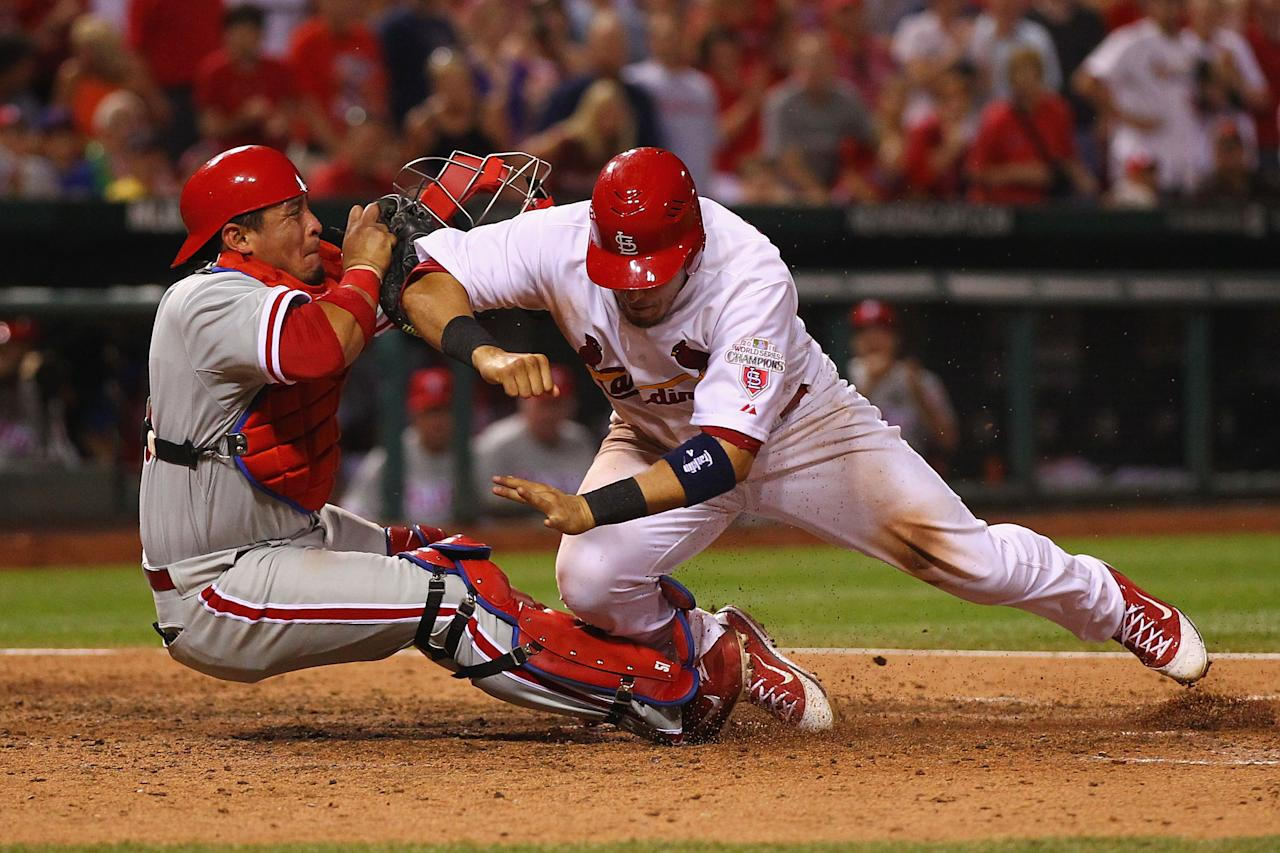 ST. LOUIS, MO - MAY 25: Carlos Ruiz #51 of the Philadelphia Phillies tags out Yadier Molina #4 of the St. Louis Cardinals at Busch Stadium on May 25, 2012 in St. Louis, Missouri.  (Photo by Dilip Vishwanat/Getty Images)