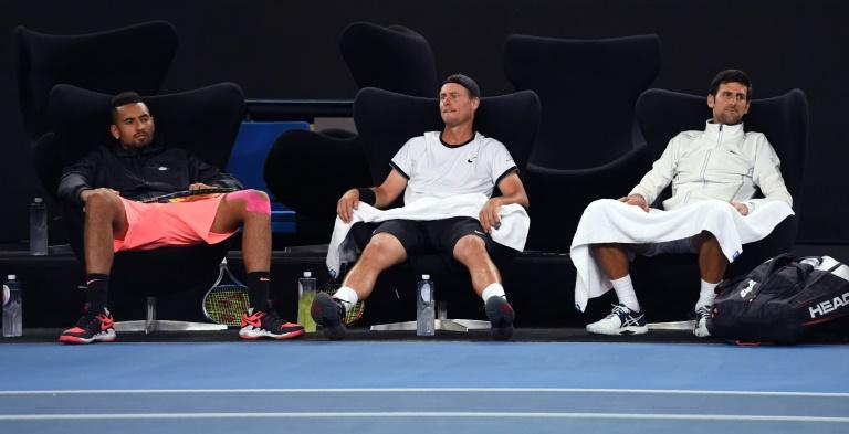 "Nick Kyrgios, (L) Lleyton Hewitt (C) and Novak Djokovic  watch the action during the ""Tie Break Tens"" tennis tournament in Melbourne"