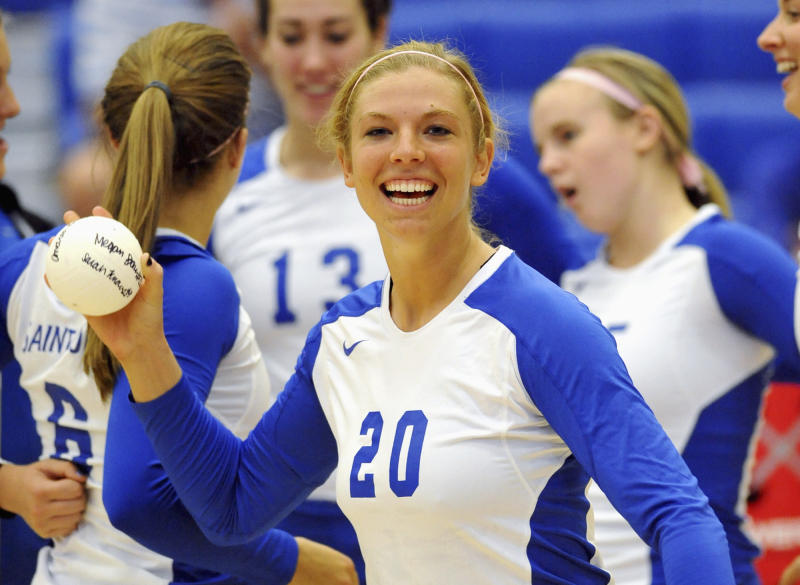 FILE - This 2010 photo provided Aug. 20, 2012 by Saint Louis University Athletics shows former volleyball player Megan Boken before a match in St. Louis. Boken, 23, a Wheaton, Ill. native who graduated in 2011, was shot and killed during a suspected robbery attempt Saturday, Aug. 17, 2012, while visiting  St. Louis from the Chicago area. The St. Louis Circuit Attorney's office announced Friday, Aug. 24, 2012, that two 18-year-old cousins have been charged in Bokens' death. (AP Photo/Saint Louis University Athletics, File)