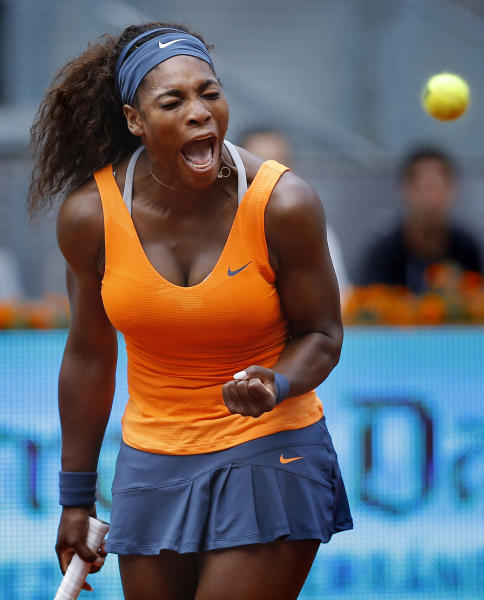 Serena Williams from the U.S. celebrates a point against Anabel Medina from Spain during the Madrid Open tennis tournament, in Madrid Friday, May 10, 2013. (AP Photo/Daniel Ochoa de Olza)