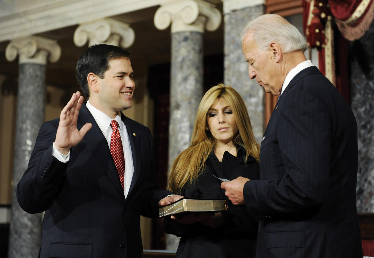 U.S. Senator Marco Rubio (R-FL) (L) stands next to his wife Jeanette Rubio as he takes part in a ceremonial re-enactment of his swearing-in by Vice President Joe Biden in the Old Senate Chamber at the U.S. Capitol in Washington January 5, 2011. REUTERS/Jonathan Ernst (UNITED STATES - Tags: POLITICS)