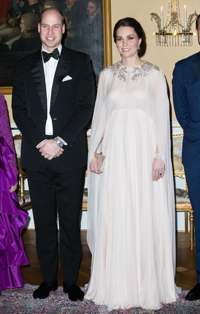 For an evening dinner held at the Royal Palace in Oslo on day three of the tour, the Duchess of Cambridge, who was pregnant with Prince Louis at the time, wore a caped Alexander McQueen gown in blush pink. <em>[Photo: Getty]</em>