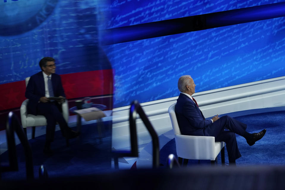 Democratic presidential candidate former Vice President Joe Biden participates in a town hall with moderator ABC News anchor George Stephanopoulos, seen reflected at left, at the National Constitution Center in Philadelphia, Thursday, Oct. 15, 2020. (AP Photo/Carolyn Kaster)
