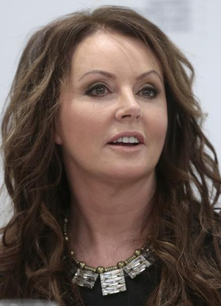 British singer Sarah Brightman speaks during news conference in Moscow, Russia, Wednesday, Oct. 10, 2012. Brightman is to become the first-ever global recording artist to take a spaceflight, teaming up with Space Adventures for a journey to the International Space Station (ISS). (AP Photo/Mikhail Metzel)