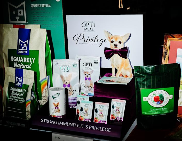 """Opti Meal's line of Privilege dog food, among many offerings for the pampered pooch. <span class=""""copyright"""">(Zack Wittman / For The Times)</span>"""