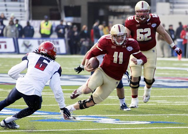 Boston College quarterback Chase Rettig (11) rushes for short yards as Arizona cornerback Jonathan McKnight (6) defends during the first half of the AdvoCare V100 Bowl NCAA college football game, Tuesday, Dec. 31, 2013, at Independence Stadium in Shreveport, La. (AP Photo/Rogelio V. Solis)
