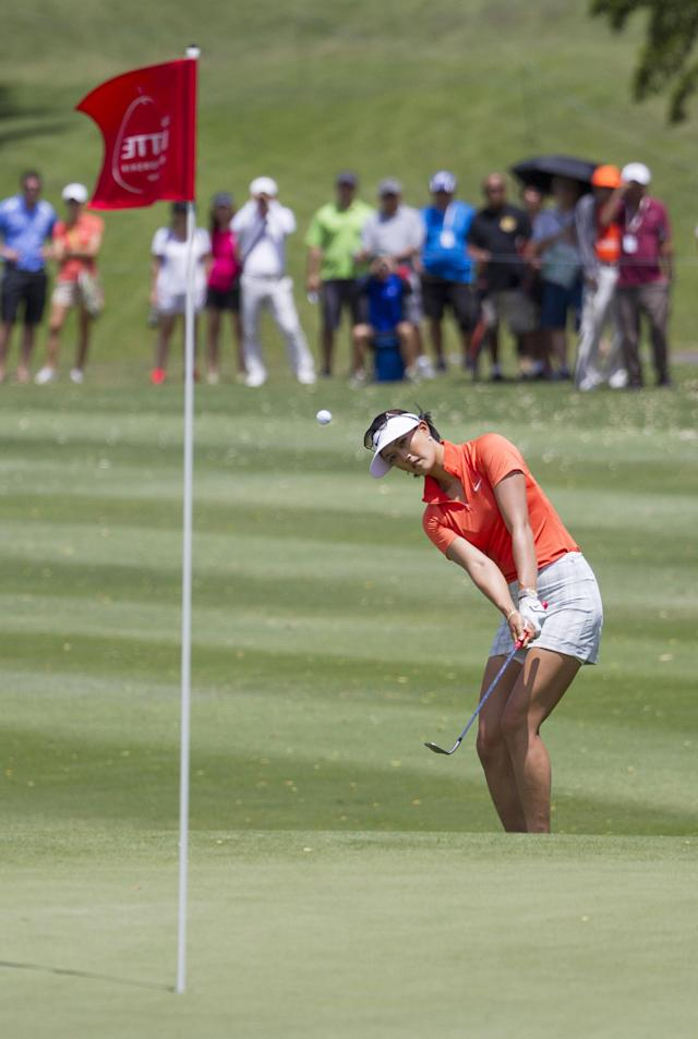Michelle Wie chips onto the first green in the final round of the LPGA LOTTE Championship golf tournament at Ko Olina Golf Club, Saturday, April 19, 2014, in Kapolei, Hawaii. (AP Photo/Eugene Tanner)