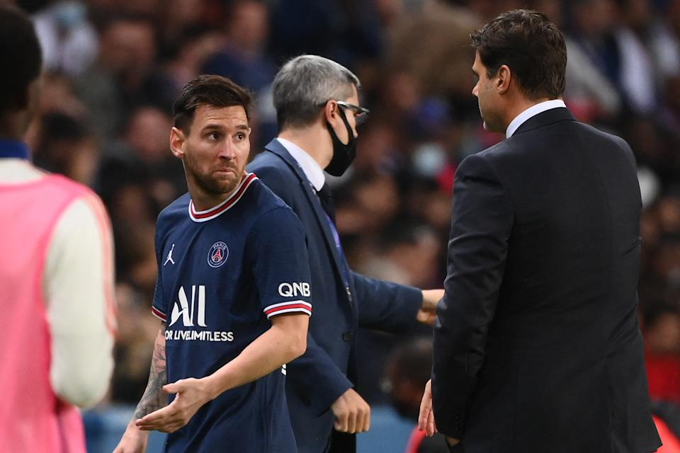 Paris Saint-Germain's Argentinian forward Lionel Messi (L0 leaves the pitch after chatting with Paris Saint-Germain's Argentinian head coach Mauricio Pochettino during the French L1 football match between Paris-Saint Germain (PSG) and Olympique Lyonnais at The Parc des Princes Stadium in Paris on September 19, 2021. (Photo by FRANCK FIFE / AFP) (Photo by FRANCK FIFE/AFP via Getty Images)
