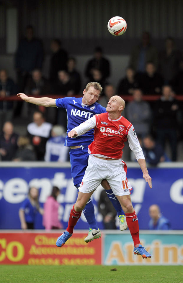 Morecambe's Kevin Ellison (Right) and Chesterfield's Ritchie Humphreys contest a header during the Sky Bet League Two match at Globe Arena, Morecambe.