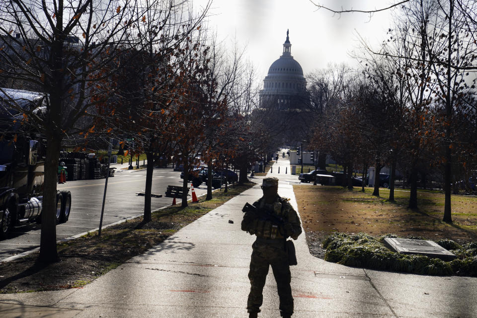 The U.S. Capitol is seen through security fencing on Saturday, Jan. 16, 2021, in Washington as security is increased ahead of the inauguration of President-elect Joe Biden and Vice President-elect Kamala Harris. (AP Photo/John Minchillo)