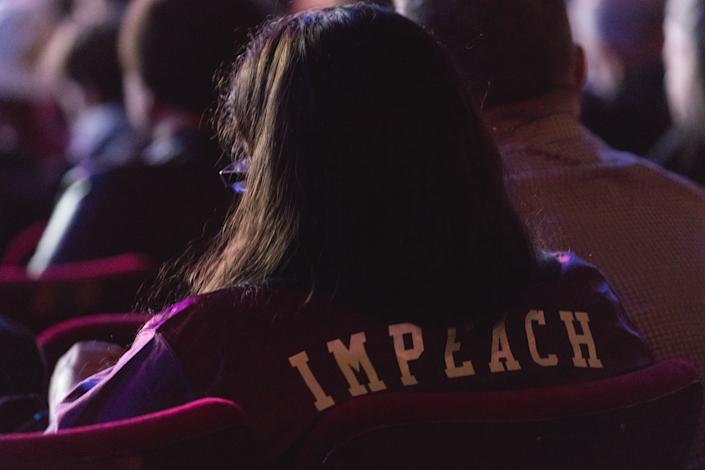 "A guest in the audience wears an ""Impeach"" jacket, at ""The People's State Of The Union"" at The Town Hall theater in New York City, NY, on Jan. 29, 2018. (Photo: Cheriss May/NurPhoto)"