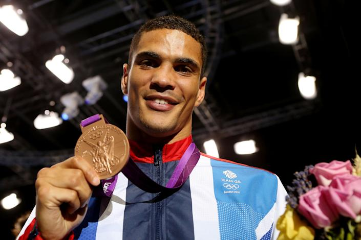 LONDON, ENGLAND - AUGUST 11:  Bronze medalist Anthony Ogogo of Great Britain celebrates after the medal ceremony for the Men's Middle (75kg) Boxing final bout on Day 15 of the London 2012 Olympic Games at ExCeL on August 11, 2012 in London, England.  (Photo by Scott Heavey/Getty Images)