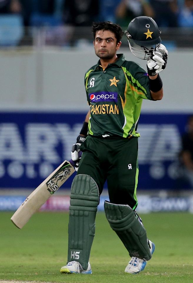 DUBAI, UNITED ARAB EMIRATES - DECEMBER 20:  Ahmed Shahzad of Pakistan celebrates after reaching his century during the second One-Day International (ODI ) match between Sri Lanka and Pakistan at the Dubai Sports City Cricket Stadium on December 20, 2013 in Dubai, United Arab Emirates.  (Photo by Francois Nel/Getty Images)