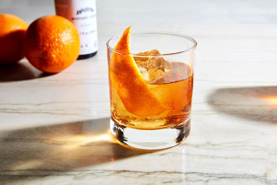 """Getting cocktails to-go is a great way to support your struggling local bars (if it's allowed where you live). But this year has also been a big one for making drinks at home. This classic <a href=""""https://www.epicurious.com/recipes-menus/whiskey-cocktails-drink-recipes-gallery?mbid=synd_yahoo_rss"""" rel=""""nofollow noopener"""" target=""""_blank"""" data-ylk=""""slk:whiskey cocktail"""" class=""""link rapid-noclick-resp"""">whiskey cocktail</a> is a great place to start. (And then, you can begin <a href=""""https://www.epicurious.com/expert-advice/rules-of-riff-how-to-adjust-classic-cocktail-recipes-article?mbid=synd_yahoo_rss"""" rel=""""nofollow noopener"""" target=""""_blank"""" data-ylk=""""slk:riffing"""" class=""""link rapid-noclick-resp"""">riffing</a>.) <a href=""""https://www.epicurious.com/recipes/food/views/old-fashioned-235804?mbid=synd_yahoo_rss"""" rel=""""nofollow noopener"""" target=""""_blank"""" data-ylk=""""slk:See recipe."""" class=""""link rapid-noclick-resp"""">See recipe.</a>"""