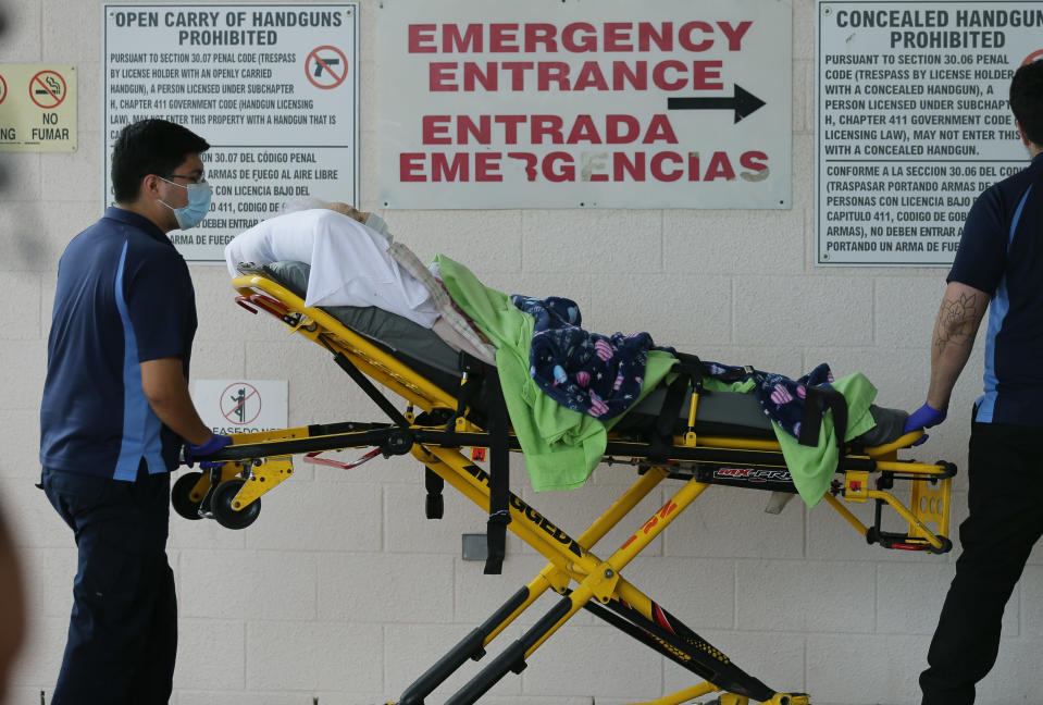 Medical workers deliver a patient with COVID-19 to the Emergency Room at Star County Memorial Hospital, Monday, July 27, 2020, in Rio Grande City, Texas. (AP Photo/Eric Gay)