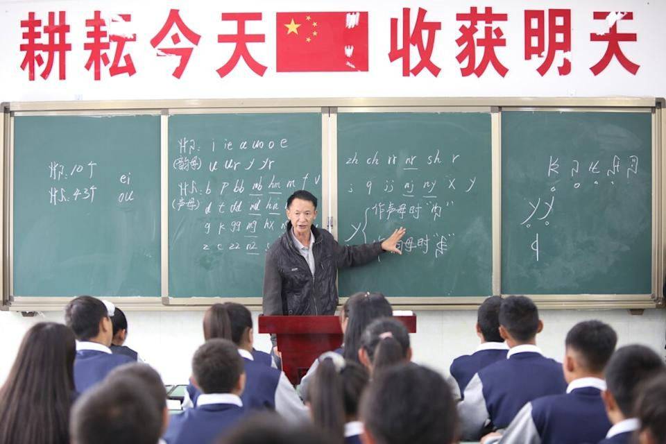 Students study written ethnic Yi language in class at Wenchang Middle School in Liangshan Yi autonomous prefecture. The schools provide education for children of poor families relocated from inhospitable areas. Photo: Simon Song