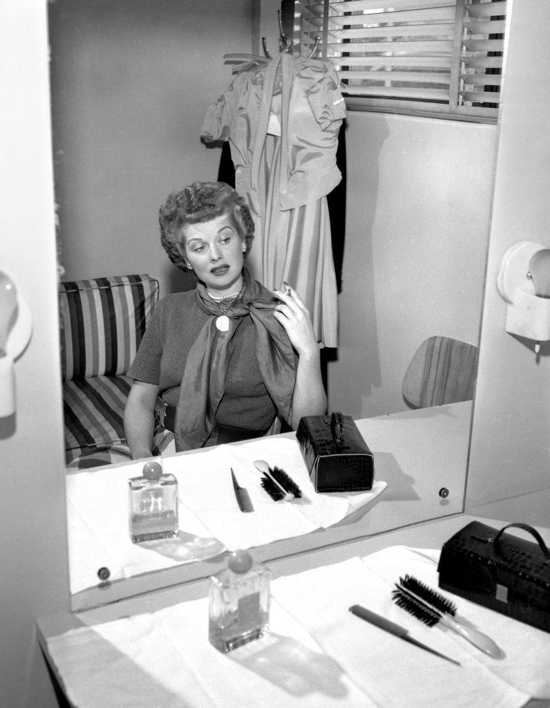 <p>Lucille prepares in her dressing room at CBS radio for the upcoming installment of the Screen Guild Program's radio adaption of <em>It Had to Be You</em>. </p>