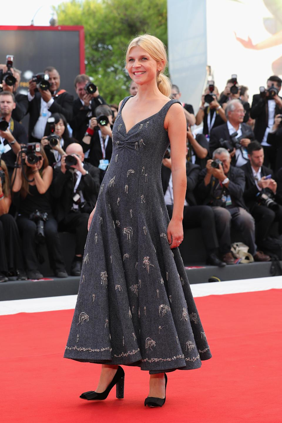 <p>The French star walked the red carpet in a printed V-neck dress. <em>[Photo: Getty]</em> </p>