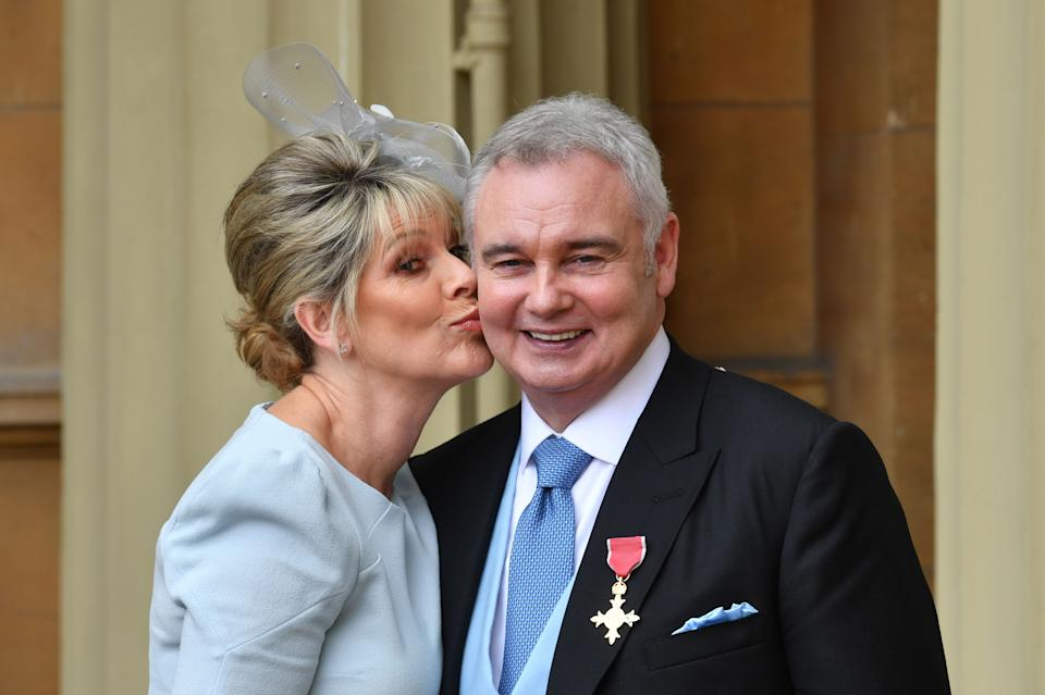 Journalist and broadcaster, Eamonn Holmes, (R), with his wife Ruth Langsford, poses with his medal after he was appointed Officer of the Order of the British Empire (OBE) for services to broadcasting, by Britain's Queen Elizabeth II during an investiture ceremony at Buckingham Palace in London on June 1, 2018. (Photo by John Stillwell / POOL / AFP)        (Photo credit should read JOHN STILLWELL/AFP via Getty Images)
