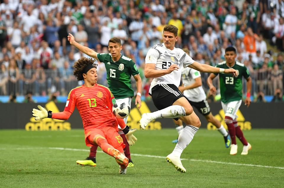 <p>Guillermo Ochoa of Mexico makes a save from a shot by Mario Gomez of Germany during the 2018 FIFA World Cup Russia group F match between Germany and Mexico at Luzhniki Stadium on June 17, 2018 in Moscow, Russia. (Photo by Dan Mullan/Getty Images) </p>