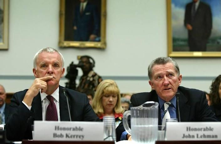 Sen. Bob Kerrey (L) and John Lehman (R) testify to the House of Representatives Government Reform Committee in 2004.