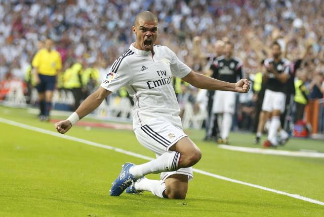 "Real Madrid's Pepe celebrates after scoring against Barcelona during their Spanish first division ""Clasico"" soccer match at the Santiago Bernabeu stadium in Madrid October 25, 2014. REUTERS/Sergio Perez (SPAIN - Tags: SOCCER SPORT)"