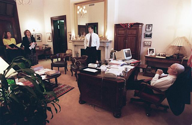 <p>Press secretary Nancy Ives, legislative director Ann Sauer and John Raidt, the Commerce Committee staff director for the majority, brief Sen. John McCain after he arrived in the early afternoon from a trip to Hawaii to celebrate his 18th wedding anniversary with his wife, Cindy, and to address the Hawaii GOP on May 18, 1998. (Photo: Scott J. Ferrell/Congressional Quarterly/Getty Images) </p>