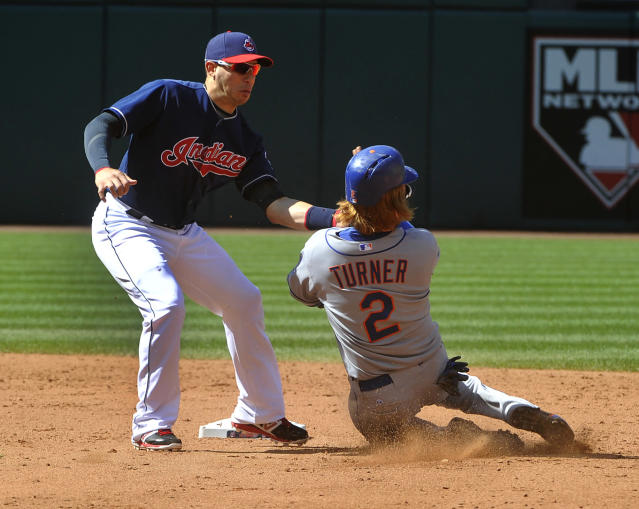 New York Mets' Justin Turner (2) is tagged out at second base on a steal attempt by Cleveland Indians shortstop Asdrubal Cabrera during the sixth inning of a baseball game in Cleveland, Sunday, Sep. 8, 2013. Turner was shaken up on the play but stayed in the game. (AP Photo/Phil Long)