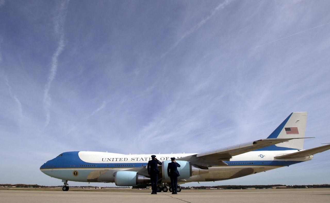 FILE - In this Nov. 6, 2016 file photo, military personnel salute as Air Force One, with President Barack Obama aboard, departs at Andrews Air Force Base, Md. President-elect Donald Trump wants the government's contract for a new Air Force One canceled. ( AP Photo/Jose Luis Magana)