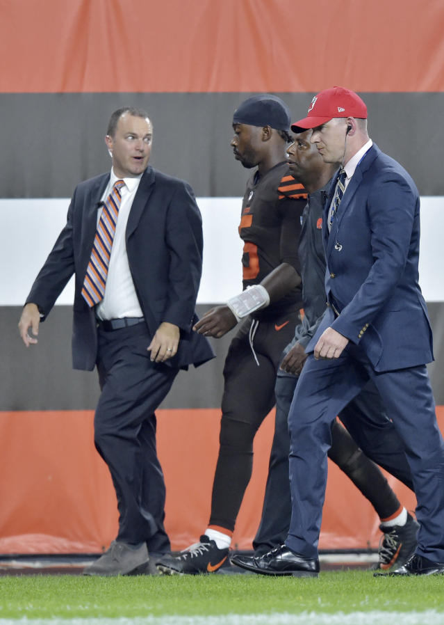 Cleveland Browns quarterback Tyrod Taylor, second from left, walks to the locker room during the first half of the team's NFL football game against the New York Jets, Thursday, Sept. 20, 2018, in Cleveland. (AP Photo/David Richard)