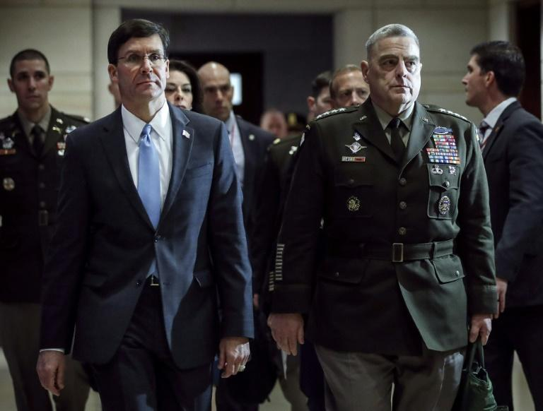 US Secretary of Defense Mark Esper (L) and Chairman of the Joint Chiefs of Staff General Mark Milley (R) arrive in Congress to brief lawmakers about the situation with Iran